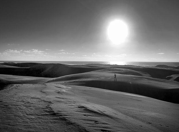 Runner on dunes b&w